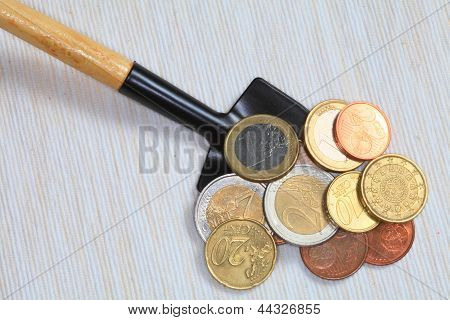 Coins And Shovel.