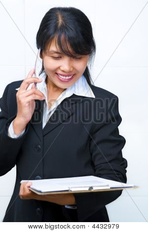 Young Beautiful Businesswoman Having Discussion Over The Phone