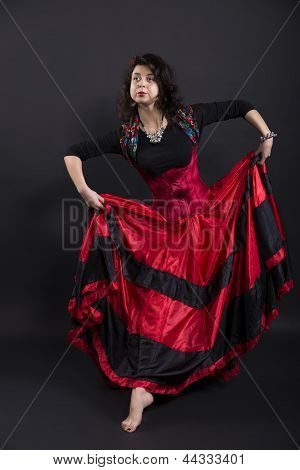 Young Romany Woman Pose In Spanish Traditional Clothes