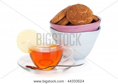 Glass cup of black tea with lemon and cookies. Isolated on white background