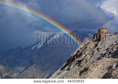 Alps high mountains and rainbow.