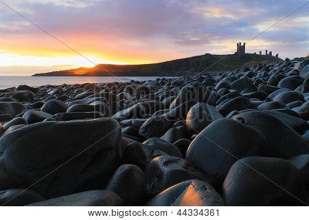 Sunrise Over Dunstanburgh Castle