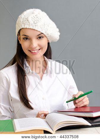Beautiful student girl wearing a beret.