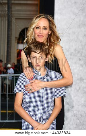 LOS ANGELES - APR 9:  Kim Raver, son arrives at the