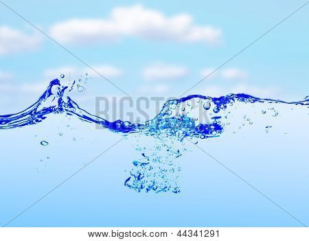 Water and air bubbles over sky background