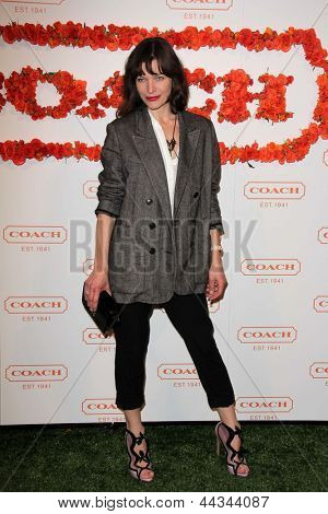 LOS ANGELES - APR 10:  Milla Jovovich arrives at the Coach's 3rd Annual Evening of Cocktails and Shopping at the Bad Robot on April 10, 2013 in Santa Monica, CA