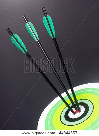 Three Green Black Archery Arrows Hit Round Target Bullseye Center