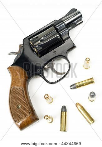 Wood Handled Revolver 38 Caliber Pistol Loaded Laying With Bullets
