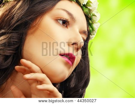 beauty woman with flower on green