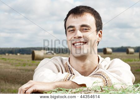 Young smiling men in national belorussian costume