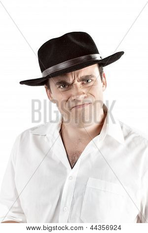 Portrait of angry young man in black hat.