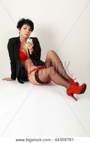 Brunette In Red With Smartphone