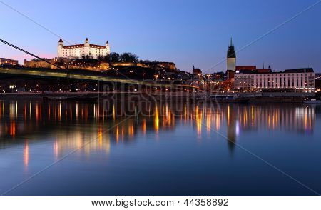 Bratislava Castle And Novy Bridge At Sunset With Reflection