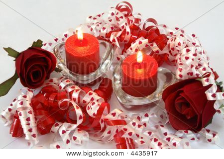 Pair Of Lit Red Candles, With Ribbon And Roses.