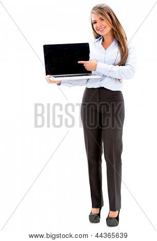 Business woman holding a laptop and showing the screen. Isolated over white
