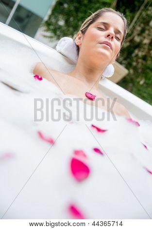 Beautiful woman taking a foam bath after a long day