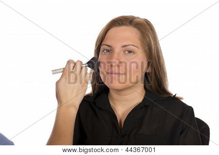 Beauty Technician Applying Makeup On Client