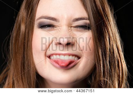 Grimacing. Young Woman Making Silly Face.