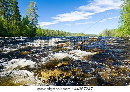 Close-up shot of rapids on the Pistojoki river in Karelia, Russia