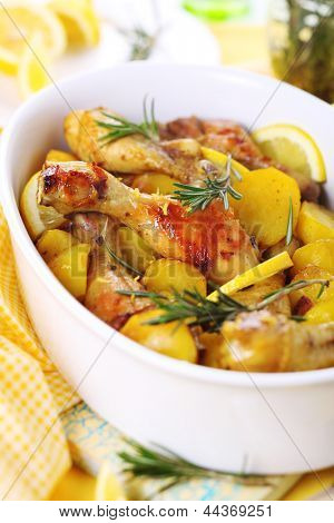 Roasted chicken with potatoes, rosemary and lemon.