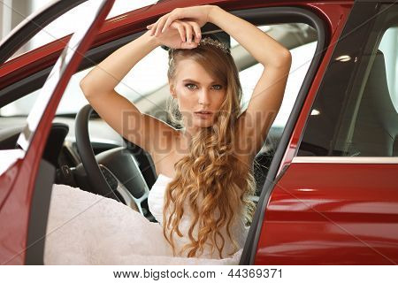 Young Bride Sits In Car