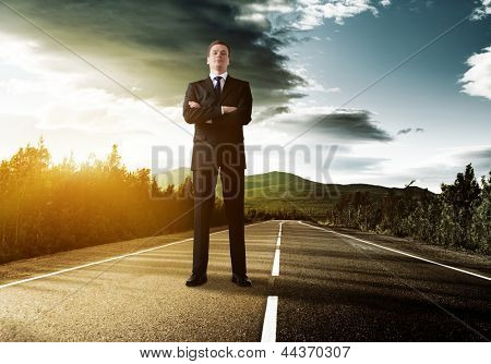 business man on the road in sunset time