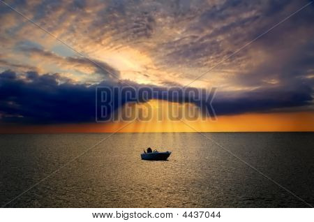 Lonely Boat Lit By Divine Light From Cloud