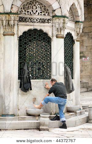 Muslim man prapering for prayer in Istanbul Turkey