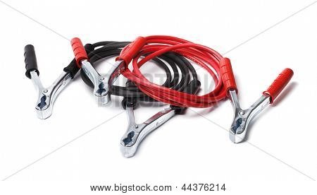 A Set of jumper cables aka jump start cables isolated on white with natural shadows.