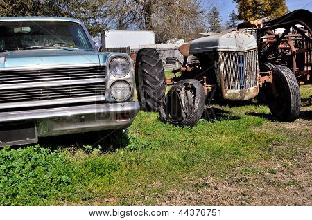 Old Rusted Car And Tractor
