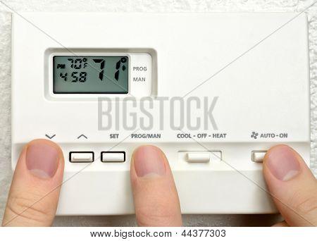 Three Persons Adjust Thermostat