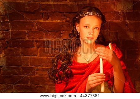 Young Girl Near The Brick Wall