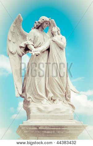 Vintage image of a winged angel guarding a beautiful young girl