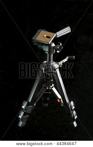 Miniature Tripod Against Black