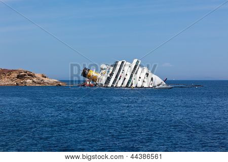 Giglio, Italy - April 28, 2012: Costa Concordia Cruise Ship At Italian Giglio Island Coastline After