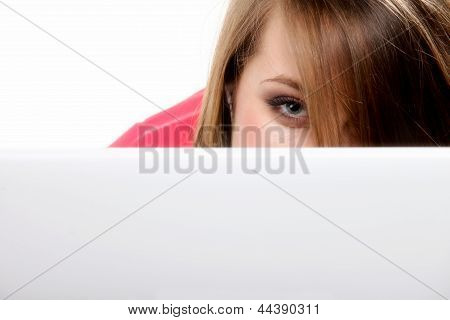 Young Woman Hiding Behind Her Laptop