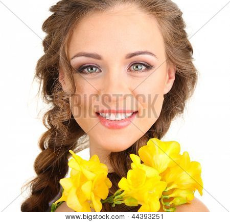 Young woman with beautiful hairstyle and flowers, isolated on white