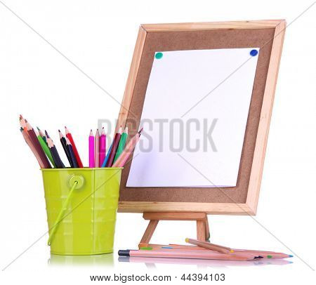 Small easel with sheet of paper with art supplies isolated on white