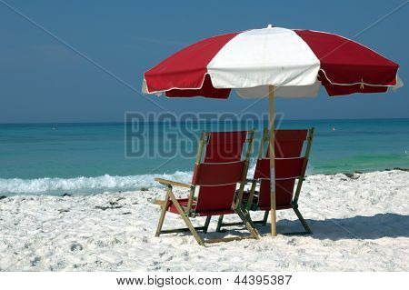 Two Red Chairs And Umbrella On White Sand Beach