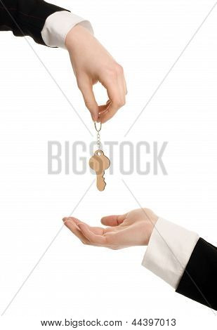 Woman hand offering a key. Woman hand receiving a key.