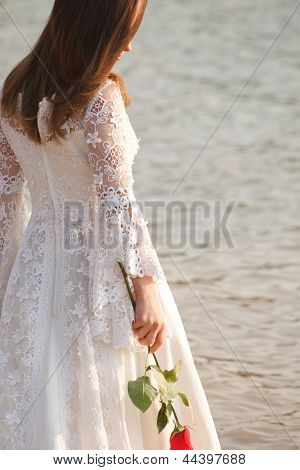 Bride Holding Rose