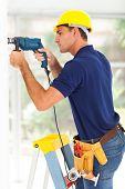 stock photo of cctv  - cctv camera installer drilling on the wall - JPG