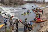 SOUTH PLATTE RIVER, EVANS, COLORADO - APRIL 6: Portaging kayak and canoes over a river diversion dam