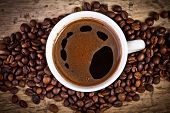 picture of negro  - Coffee cup with coffee beans on the wooden table - JPG
