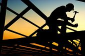 stock photo of construction industry  - Builders are building a wooden house - JPG