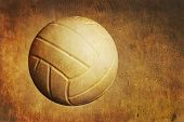 picture of volleyball  - A volleyball sits on a grunge textured background - JPG