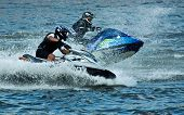 pic of jet-ski  - A jet ski and its rider leap clear of the water - JPG