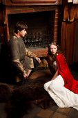 image of juliet  - Young married couple sitting near the fireplace - JPG