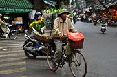 Street vendors in Hanoi selling their goods. Vietnam