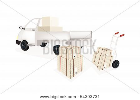 Hand Truck Loading Shipping Box Into Pickup Truck